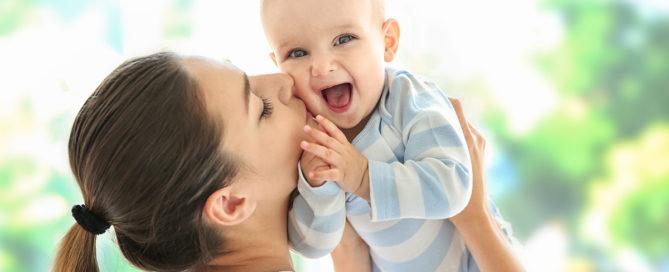 mama kissing baby - Dear Superhero Mama Parenting After Loss