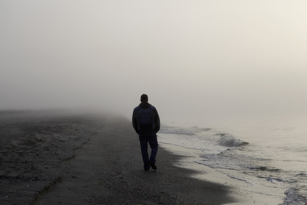 man walking on beach - Life after Loss: My Partner Has Scars Too