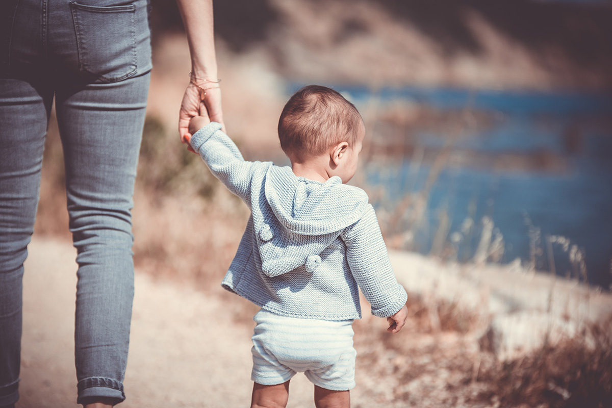 Mom holding baby's hand - 7 Things the Mom Parenting a Baby Born after Loss does Differently than other Moms