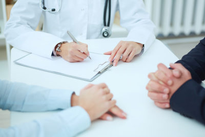 couple at preconception counseling with doctor