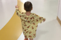 child running through hospital hallway - Please bring my baby back to me