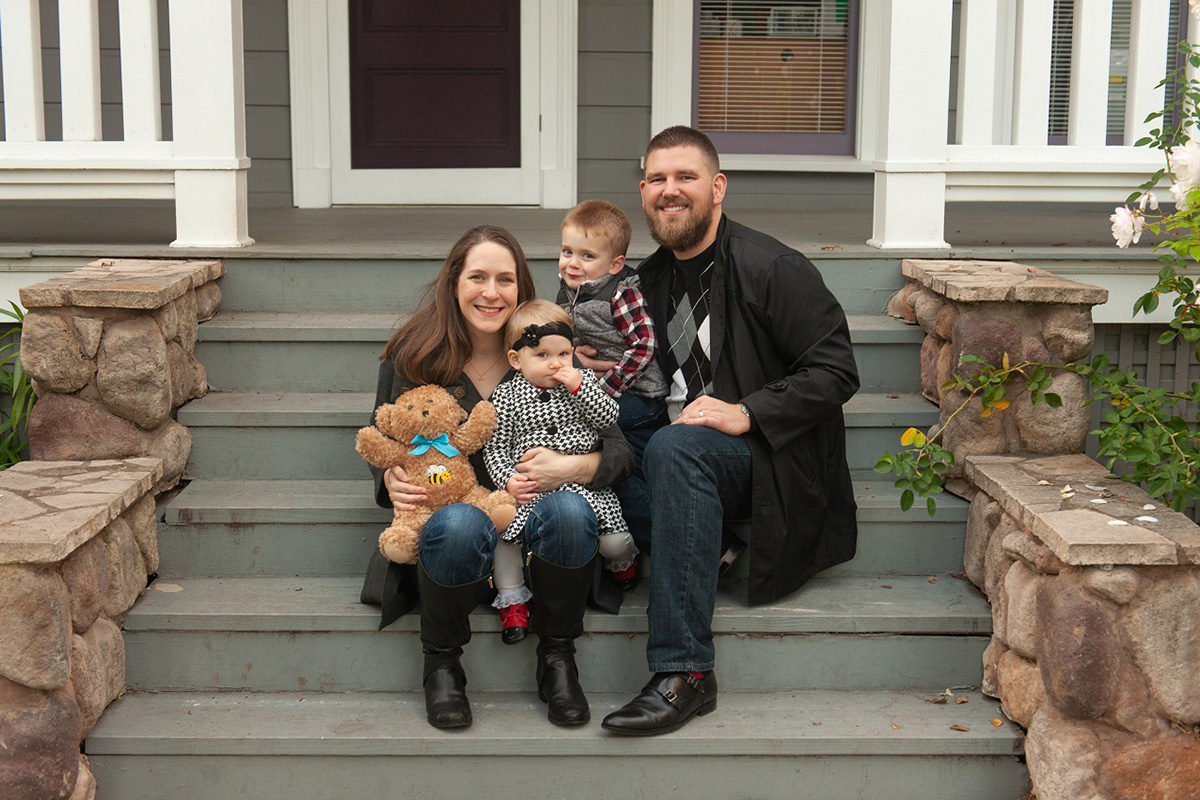 Family photo on steps - Parenting after Loss: Talking Death with Toddlers