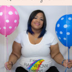 Pregnant woman holding a pink balloon and a blue balloon - Feeling Heartbroken over my Rainbow Baby's Gender