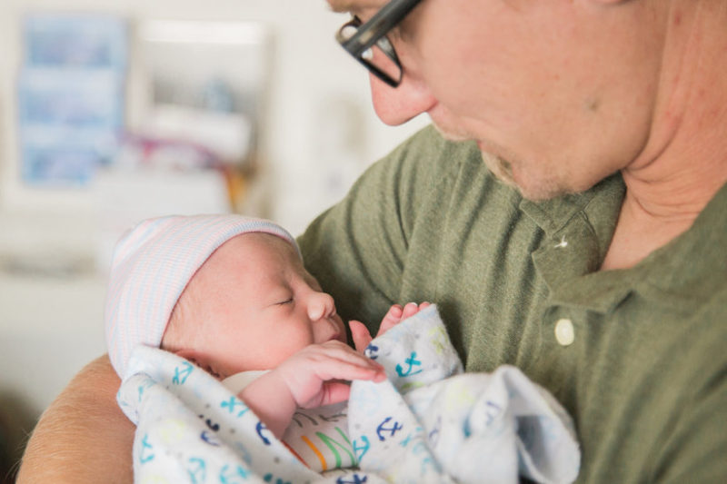dad holding baby - Why Rainbow Baby Dads Give us all the Feels