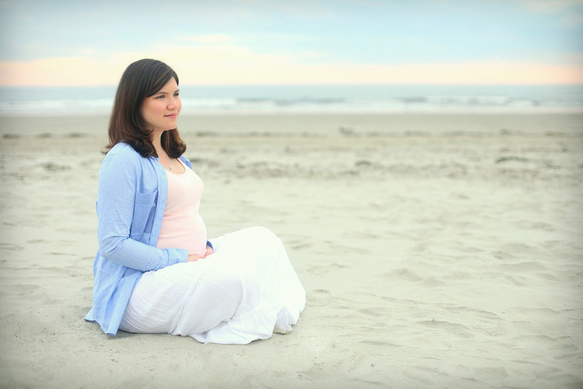 pregnant mama sitting on beach - A Letter to Myself, the Day Before Loss and Rainbows