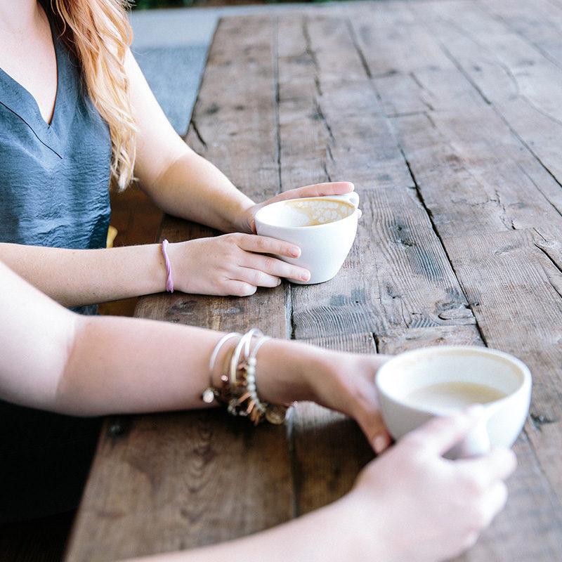 two women drinking coffee - PALS Meet-Ups
