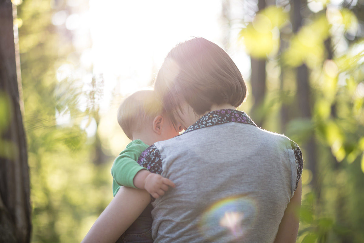Mom holding baby outdoors - There will be a moment