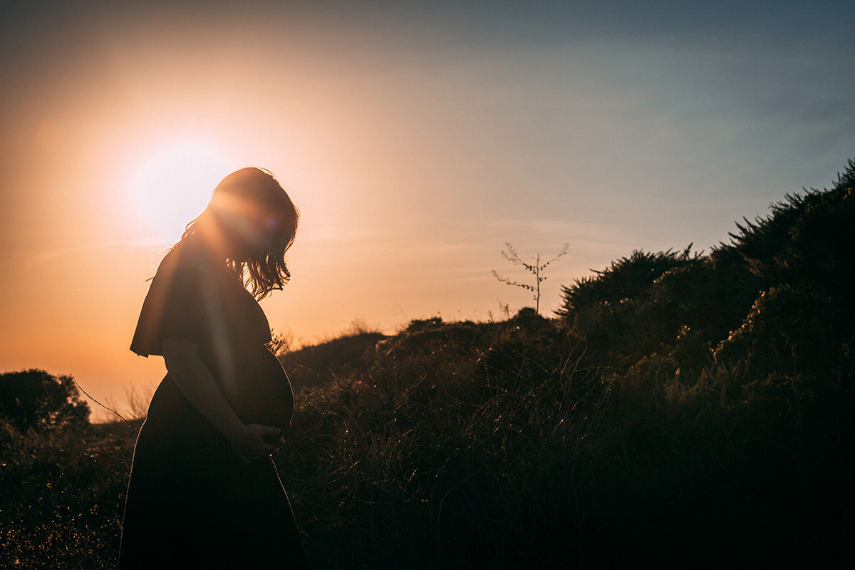 pregnant woman at dusk - Things look different during pregnancy after loss