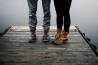 couple in boots by lake - an ode to my husband