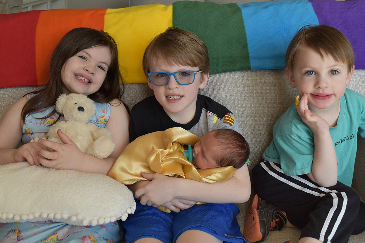 Four rainbow babies with their big sister's Molly Bear - From my first to my last