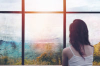 woman looking out window - Permission to grieve the miscarriage that happened before I knew I was pregnant