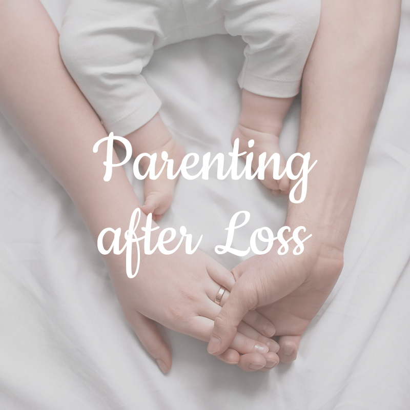 parents' hands with baby toes - parenting after loss