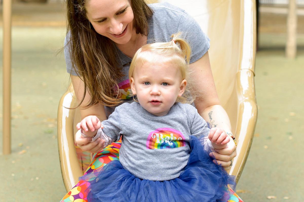 Mom and toddler on slide - 6 Harsh Realities of Loss Mom Guilt