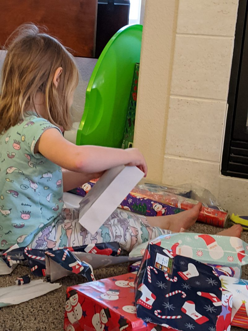 Toddler opening gifts - Rachel's Bump Day Blog, Week 26: How were the holidays, you ask?