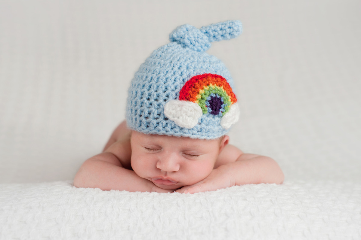 Baby with a rainbow hat - What is a rainbow baby?