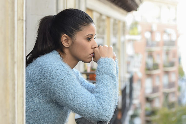 woman looking out window - Dear Loss Mom Considering Options Other Than Pregnancy