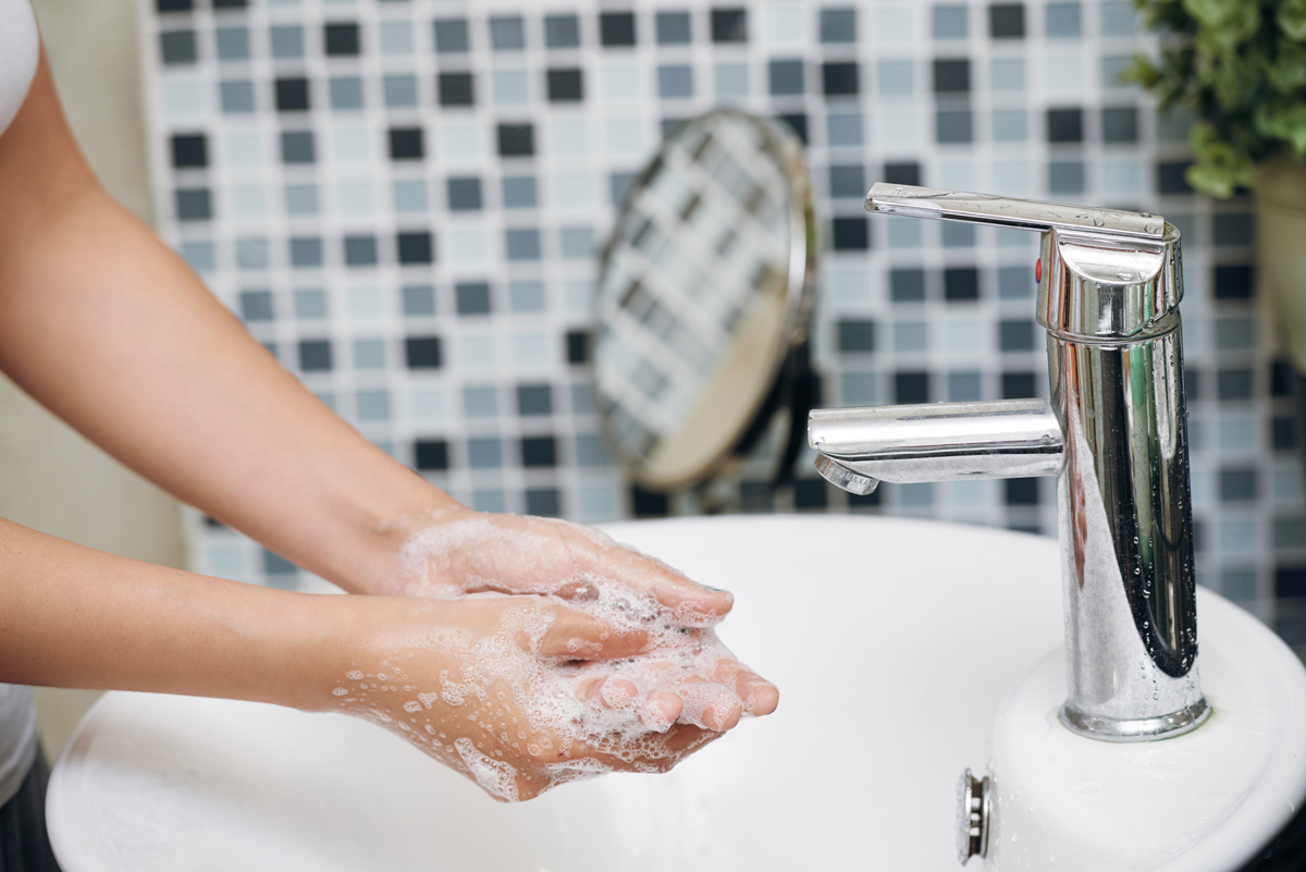 Woman washing hands - Pregnancy after Loss and the Coronavirus