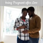pregnant couple in nursery - The 10 Most Common Questions I am Asked about being Pregnant after Loss