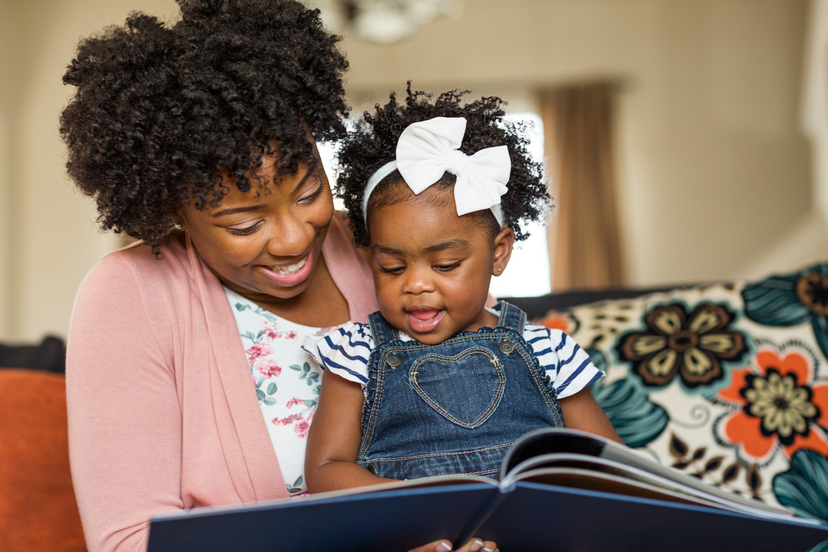 Mom reading to daughter - Favorite Books to Read to Your Baby Born After Loss