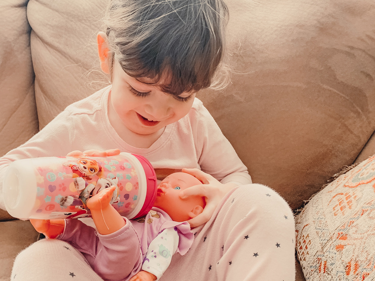 toddler feeing a baby doll - Franky's 23-week bump day blog: It's Not Just Us Anymore