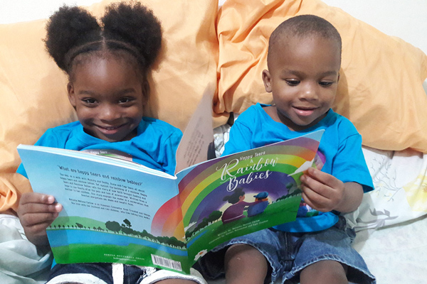 children reading a book - A Bedtime Story for Our Rainbow Babies