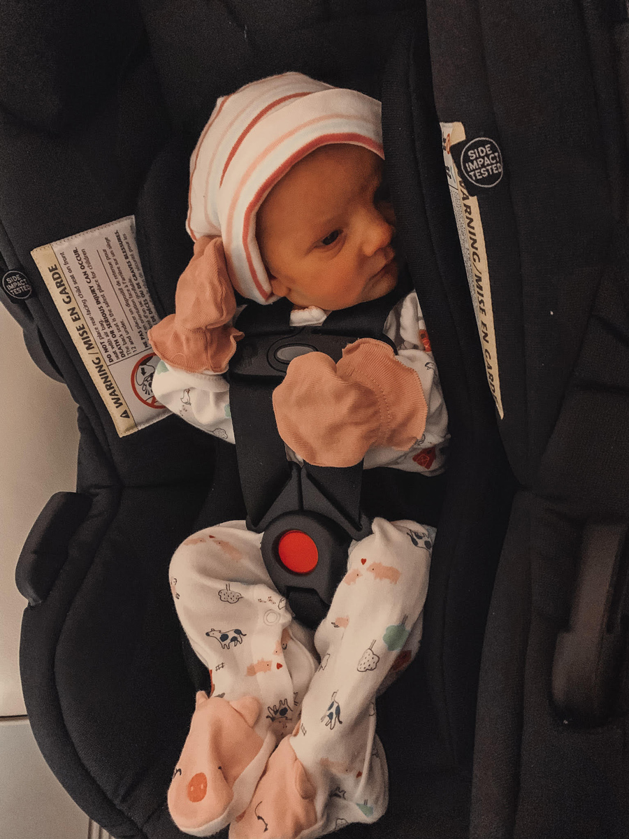 Joey in her car seat, ready to go home
