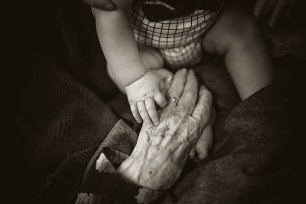 grandparent holding baby's hand - The Grandparents Who Help Carry Us Through Pregnancy After Loss are a Gift