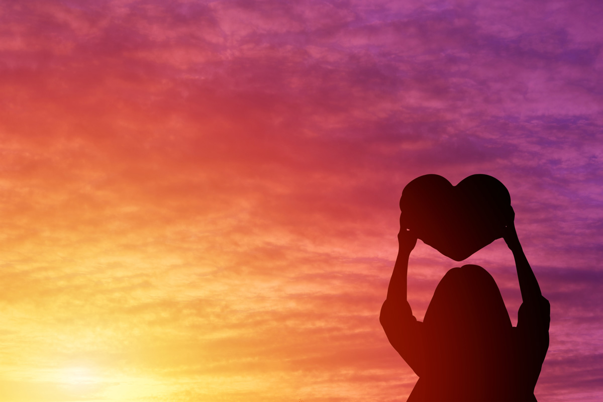 woman holding a heart - what pregnancy and infant loss awareness means