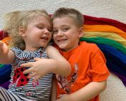 two children laying on rainbow - 10 more promises to my rainbow baby (kid)