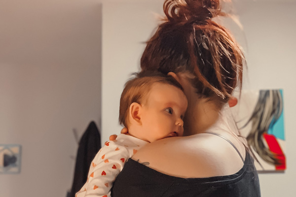 Mom holding baby - Parenthood After Loss Doesn't Look Like You Thought it Would