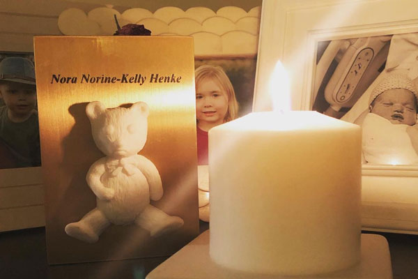 Memory candle with baby's urn and photos - honor awareness month while pregnant or parenting after loss