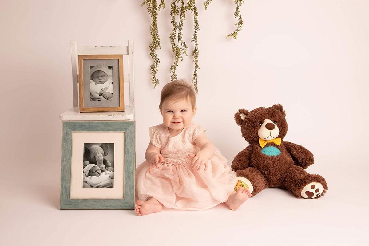 baby with photos of stillborn brother - Stillbirth is many things. Stillbirth is me.
