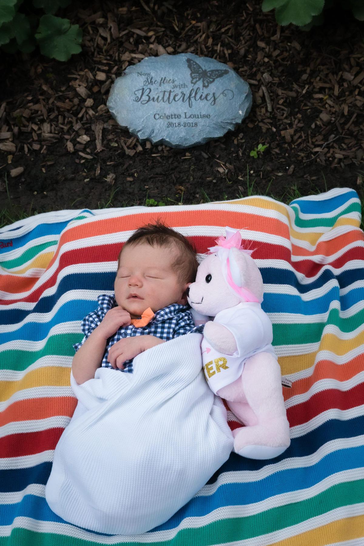 Elliott and Collete on rainbow blanket in back yard