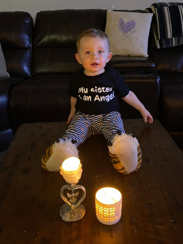 Little boy with candle for his angel sister - Finding Community while Pregnant and Parenting after Loss in a Pandemic: Maria's Story