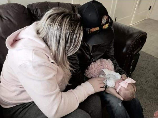 Baby Kaizlyn being held by daddy next to mommy