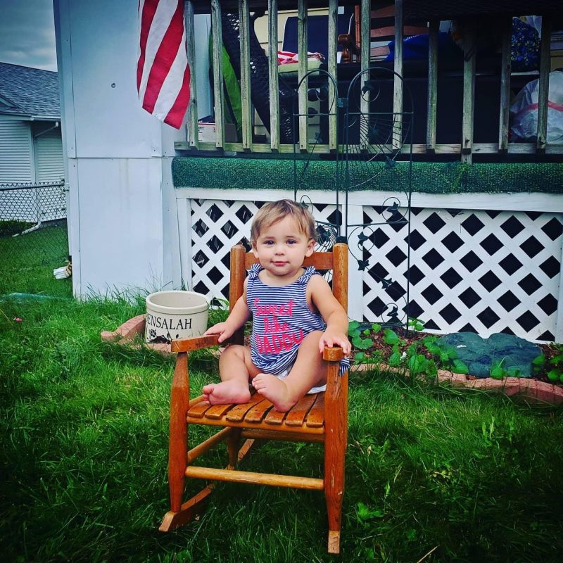 Baby in rocking chair outside - Moving after Loss