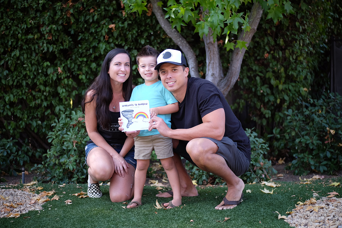 The Morrison Family holding Whirlwinds to Rainbow Children's book
