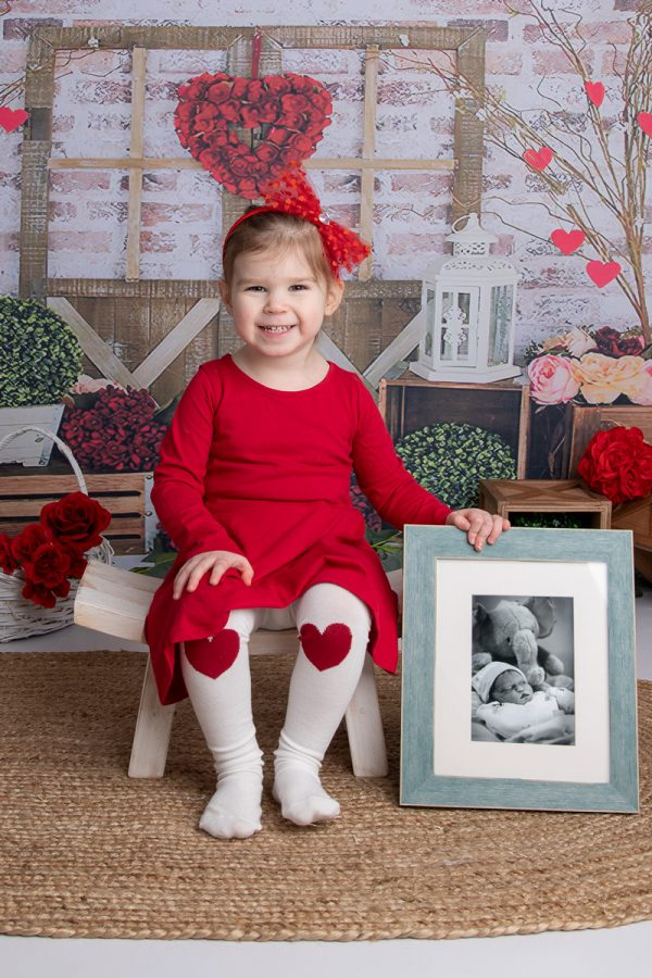 toddler with brother's picture - Mary's 33-week bump: Having Another Boy After Losing One