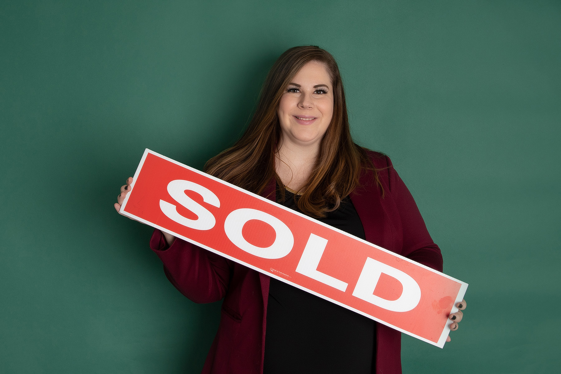 "Mary Kovacs holding ""SOLD"" sign - Mary's 34-week bump day blog: life before loss & life after loss"