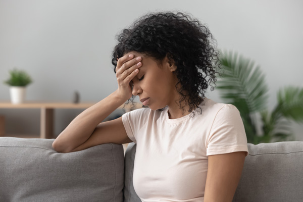 sad woman - what you need to know about first-trimester loss