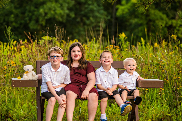 kids with Molly Bear sitting on bench - When every subsequent pregnancy is shaped by your loss