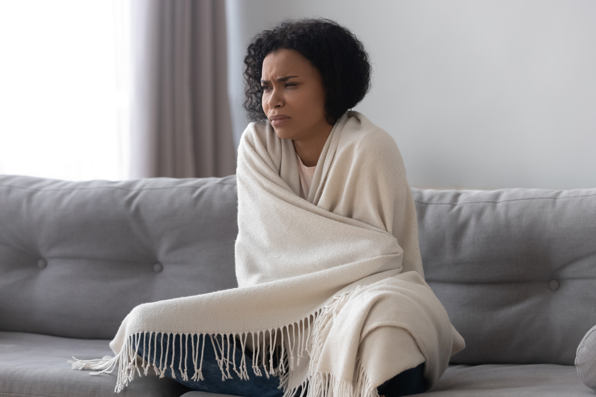 sad woman on couch - What to Expect when your Baby Dies