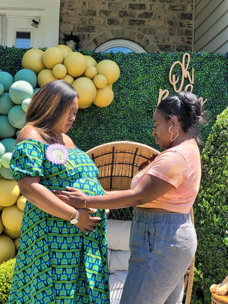 Jasmine and her sister at her baby shower