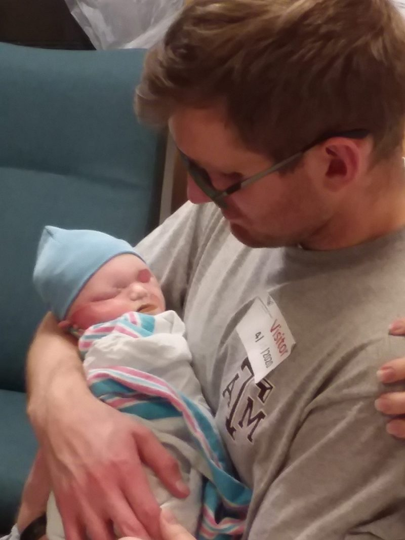 Dad holding stillborn baby