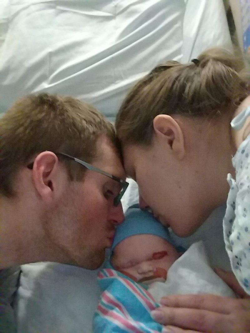 couple kissing their stillborn baby