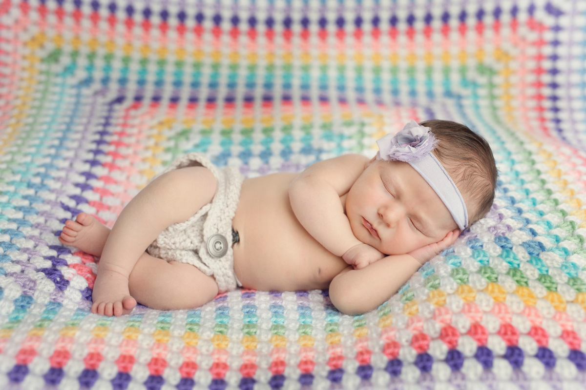 baby with rainbow blanket - Sharing the Rainbow Symbol