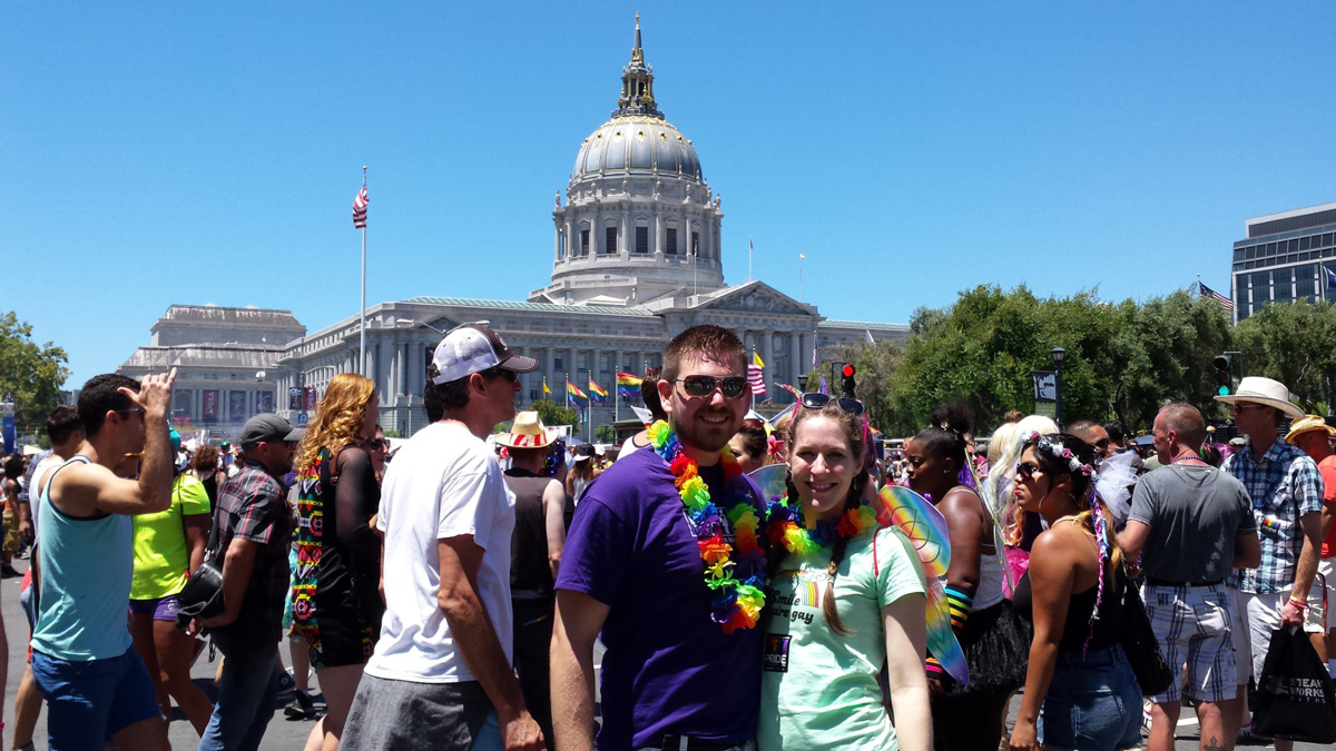 Elizabeth and Christopher Thoma at Pride - Sharing the Rainbow Symbol