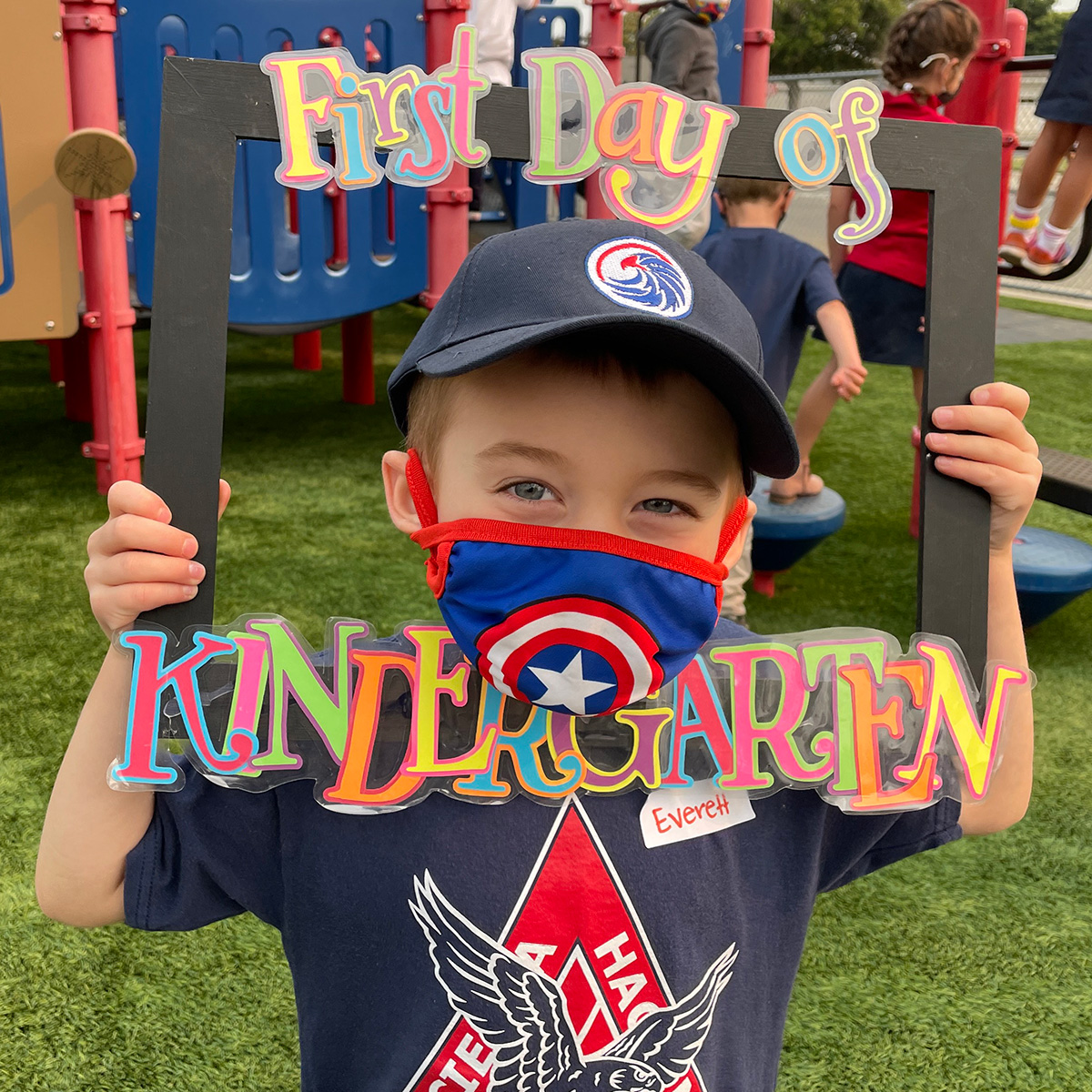 """Child holding """"First Day of Kindergarten"""" sign - Why I didn't cry at the first day of school"""