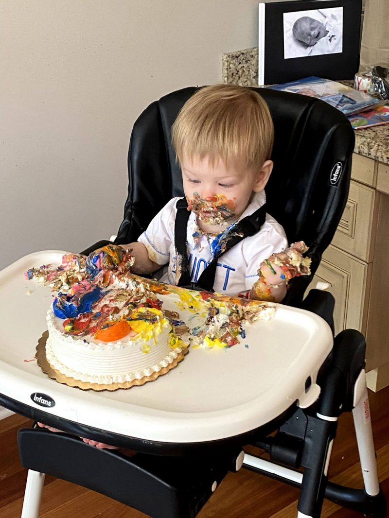 Elliot eating his birthday cake - Parenting After Loss: Sibling Photos