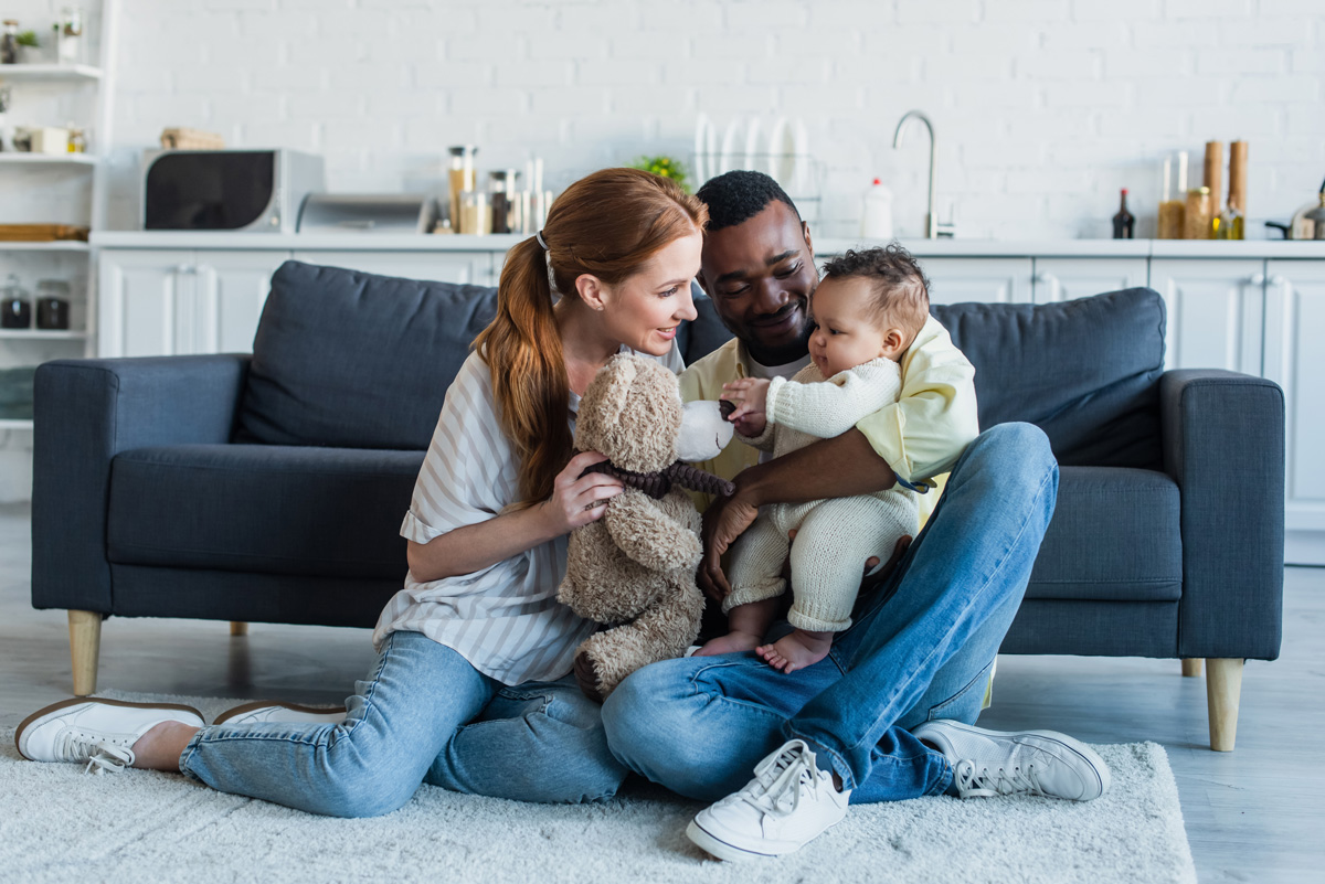 Parents with baby and teddy bear - Parenting After Loss: Making Space for Both Babies